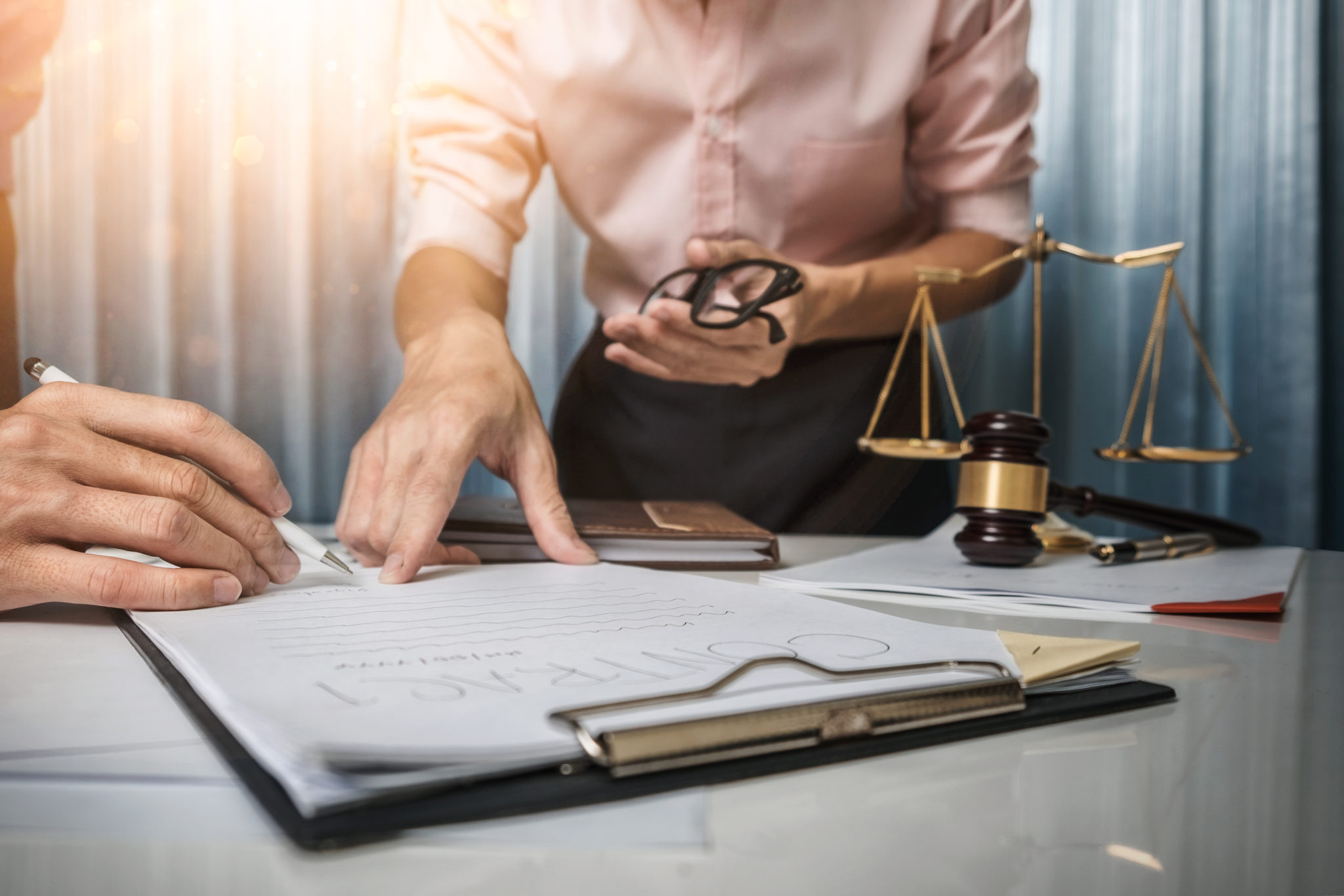 lawyer explaining to a client how much does an immigration lawyer cost